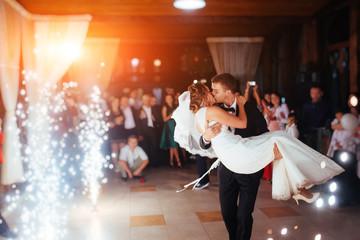 Fototapeta Happy bride and groom a their first dance, wedding obraz