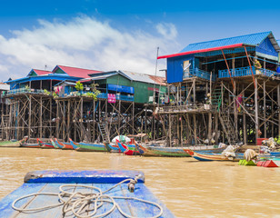 Colorful boats and stilt houses in Kampong Phluk floating village, Tonle Sap lake, Siem Reap Province, Cambodia