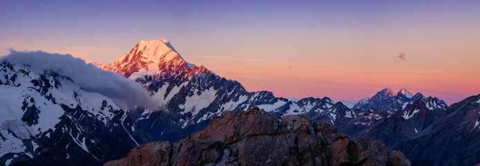 Panoramic view of Mt Cook mountain range at colorful sunset, NZ Wall mural