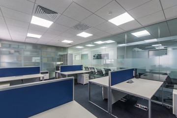 Workplaces in a bright modern open space office