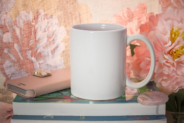 Mock-up of a white mug with some feminine stuff.