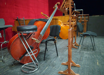 Musical instruments - double bass or contrabass are in the orchestra room. In pending of the musicians before the rehearsal.