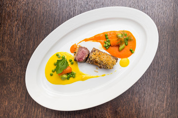 Steak of lamb with vegetable puree in the style yin yang