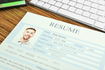 Closeup of resume file on wooden table