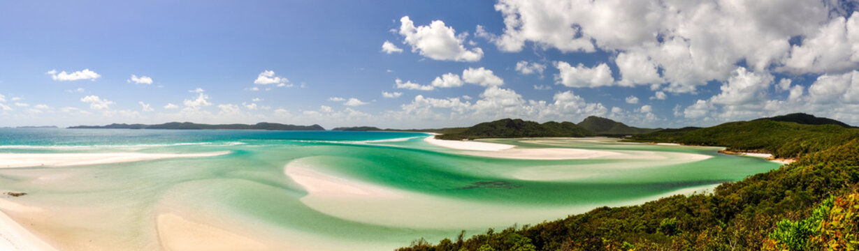 XXL panorama of Whitehaven Beach on Whitsunday Island in Queensland, Australia. The popular tourist destination is known for its pure white sands. Accessible from Airlie Beach, near Hamiltion Island.