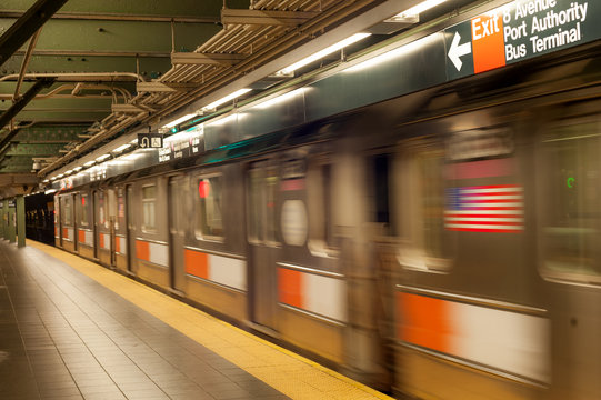 New York City subway platform with directions to Port Authority bus terminal