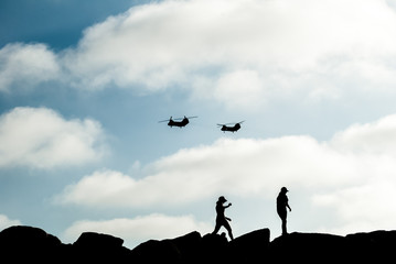 Chinook Helicopter fly over California jetty