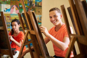 Education In Arts With Happy Student Smiling And Learning Art