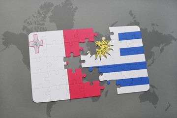 puzzle with the national flag of malta and uruguay on a world map