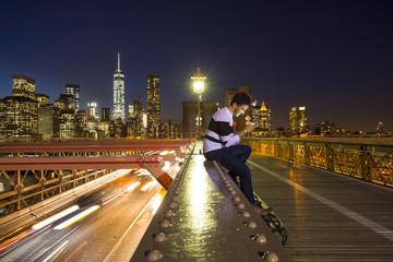 Man in Brooklyn bridge at night
