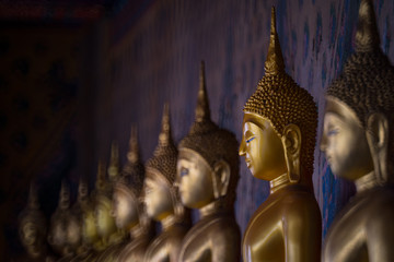 Row of Buddha image at the temple of dawn (Wat Arun) Bangkok, Thailand