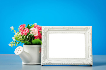 The empty white vintage photo frame.