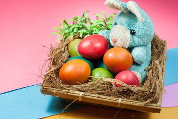 decorating Easter bunny and colorful Easter eggs