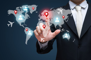 Businessman touch on screen for world business travel transport. Businessman traveling concept