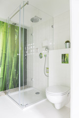 White bathroom with bamboo wallpaper
