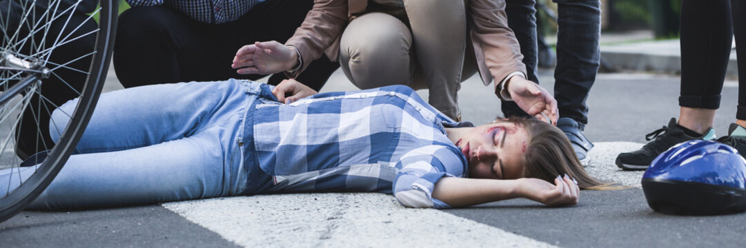 Unconscious accident victim lying on a street