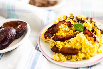 Puree of Millet Grains with Plums, Chocolate and Walnuts and Raw Ingredients on Light Tablecloth Background.