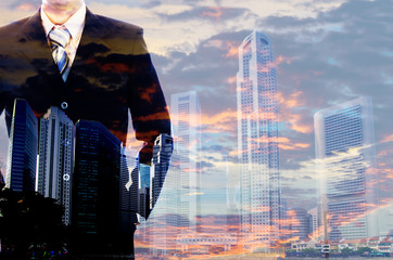 Double exposure, businessman view sunset contemporary city background. leadership,..Double exposure, businessman wearing trendy suit view sunset contemporary city background. Man power, leadership,..