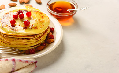 Pancakes with honey and almond on a white background. Copy space.