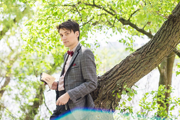 man in bow tie and jacket outdoor