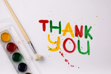 "inscription on white sheet of paper with watercolors ""Thank you"""