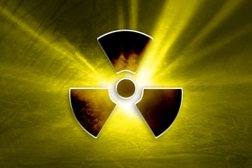 Conceptual dark grunge radioactive symbol on the textured yellow colored illustration background.