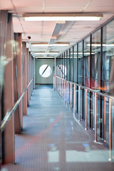 Long passages for boarding are in airports. Metal and glass constructions