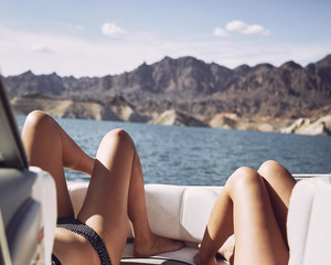 two women's legs at the front of a boat