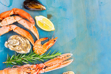 Fresh seafood set border with copy space on blue background