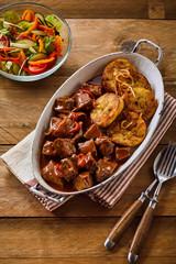 Tasty Hungarian goulash with fried dumplings