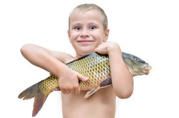 Boy holding big fish isolated on white background