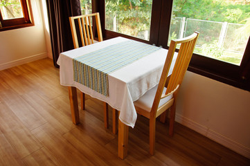 Empty dining table and window light