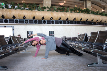 Woman Doing Yoga in airport
