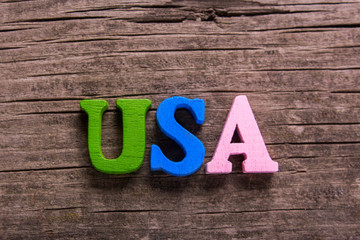 usa word made from colored wooden letters on an old table. Concept