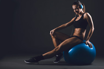 Muscular  strong   fit woman exercising