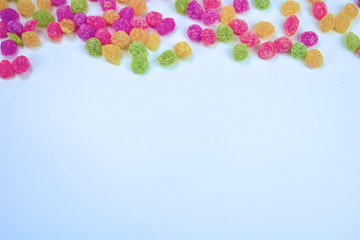 Fruit drops on the blue background