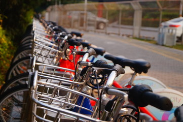 Bicycle rental facilities and a row of bicycles in the streets. In Shenzhen, china.
