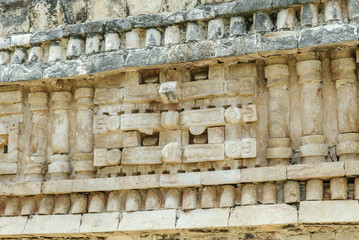 relief with the mask of the Mayan god Chaac in a building of the palace in ruins of the archaeological enclosure of Labna in Yucatan, Mexico.