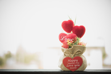 Heart-shaped Valentine's Day gifts in a sack.