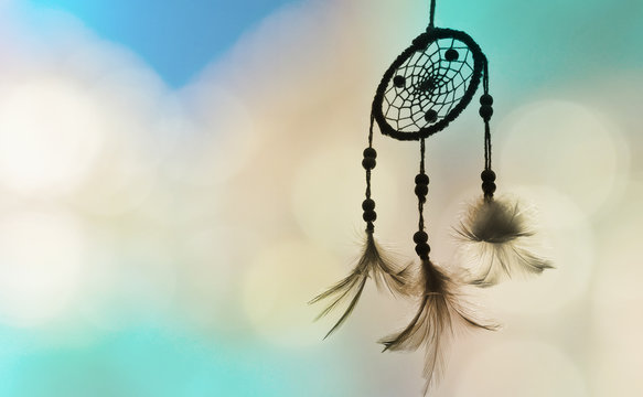 Dream catcher and sun light with blurred focus for background