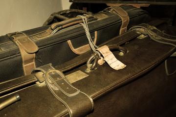 Old dusty suitcases. Vintage baggage.
