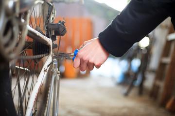Young man hand repairing his bike, prepare for another season