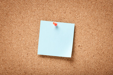 Blue blank sticky note on corkboard
