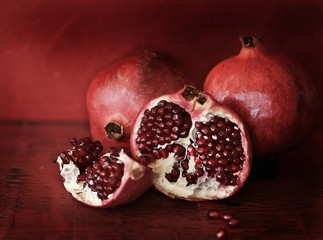 Pomegranates on red background