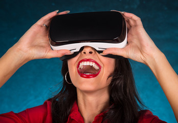 Happy woman with glasses of virtual reality.