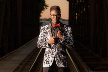 African American Teenage Male Model on Railroad Tracks