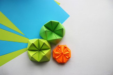 Multicolored Origami and paper  on a white table