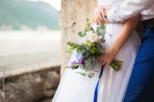 Bridal Flowers Blue Mountains : Quot bride and groom hold wedding bouquet of blue flowers