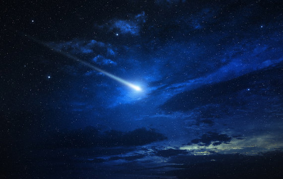 twinkling comet in a blue starry sky