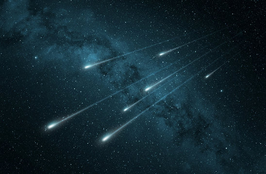 meteor shower in the starry night sky